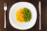 Heap of corn seeds and peas on plate
