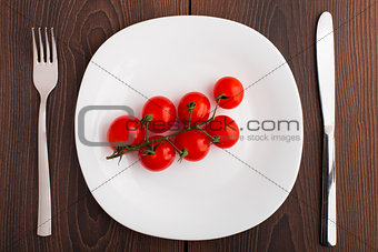 Small cherry tomato on a plate