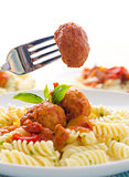 pasta with meatballs and tomato sauce on white background