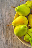 Fresh juicy pears in bowl