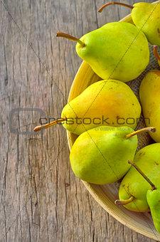 Fresh juicy pears in bowl
