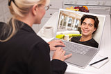 Woman In Kitchen Using Laptop Online Dating Search
