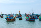 Fishing fleet anchored in front of village in Central Vietnam.