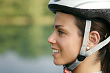 young woman training on mountain bike and cycling in park