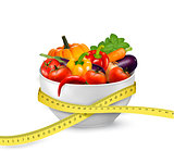Diet meal. Vegetables in a bowl with measuring tape. Concept of