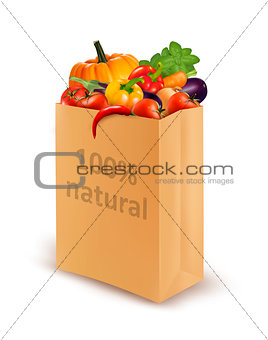 100 percent natural on a paper bag full of fresh vegetables. Con