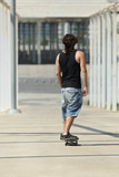 Back view of a boy in a skateboard