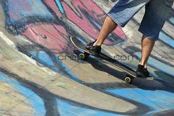 Boy legs on a skateboard