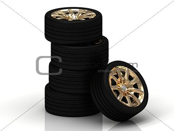 Five black wheels with gold discs