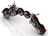 Two motorcycles standing wheel to wheel