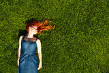 red haired girl on the grass