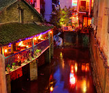Yangshuo West Street at night attracts tourists dining and night