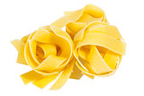 Raw pasta tagliatelle spaghetti isolated on white