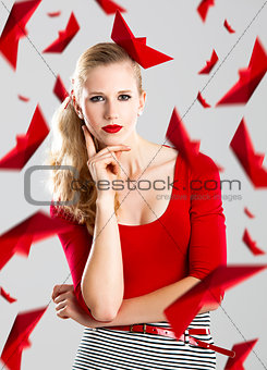 Woman with red paper boats