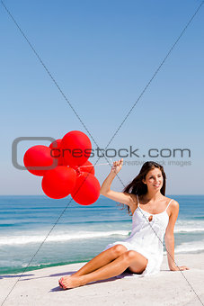 Girl with red ballons
