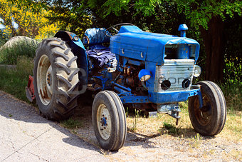 old blue tractor on the road