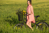 Beautiful woman with her bicycle