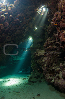 Cave in underwater tropical reef