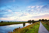 road for bicycles and river at sunrise