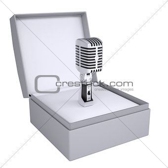 Old microphone in open gift box