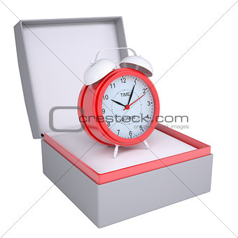 Alarm clock in open gift box