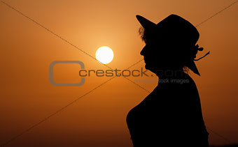 Silhouette woman portrait against orange sunset