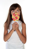 Cute little girl holding big lolly pop