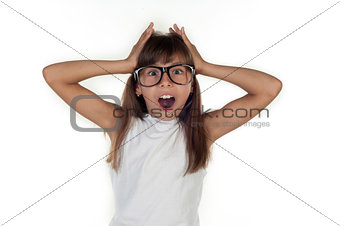 Portrait of a funny surprised girl in glasses
