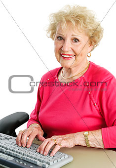 Senior Lady Using Desktop Computer