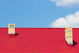 Red roof with chimneys