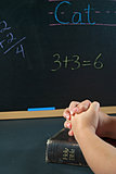 student praying in school