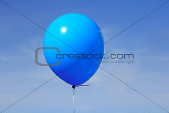 Inflatable balloon, photo on the against the blue sky