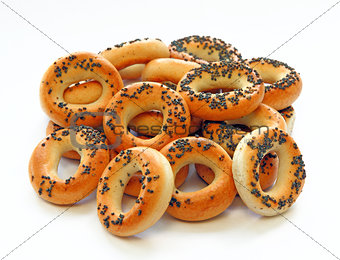 Drying bagels with poppy seeds on a white background