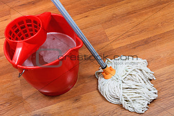 cleaning of floors by mop