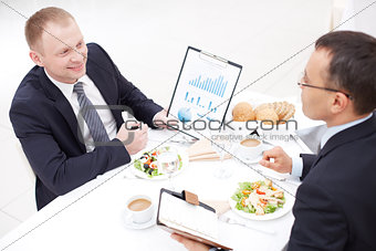 Discussing paper at lunch
