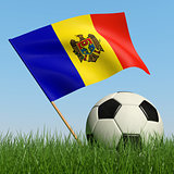 Soccer ball in the grass and flag of Moldova.