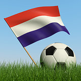Soccer ball in the grass and flag of Luxembourg.