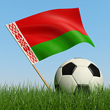 Soccer ball in the grass and flag of Belarus.