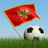 Soccer ball in the grass and flag of Montenegro.
