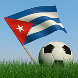 Soccer ball in the grass and the flag of Cuba