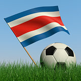 Soccer ball in the grass and the flag of Costa-Rica