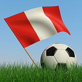 Soccer ball in the grass and the flag of Peru