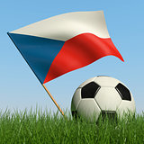 Soccer ball in the grass and flag of Czech Republic.