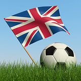Soccer ball in the grass and flag of Great Britain.