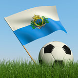 Soccer ball in the grass and flag of San-Marino.