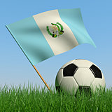 Soccer ball in the grass and the flag of Guatemala