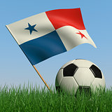 Soccer ball in the grass and the flag of Panama