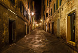 Narrow Alley With Old Buildings In Medieval Town of Siena, Tusca
