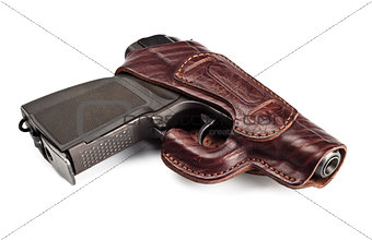 vintage pistol in leather holster