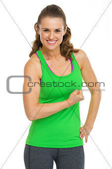 Portrait of smiling female athlete showing biceps